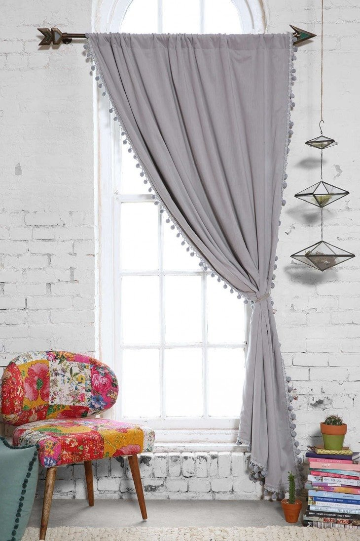 plum-and-bow-blackout-pompom-curtain