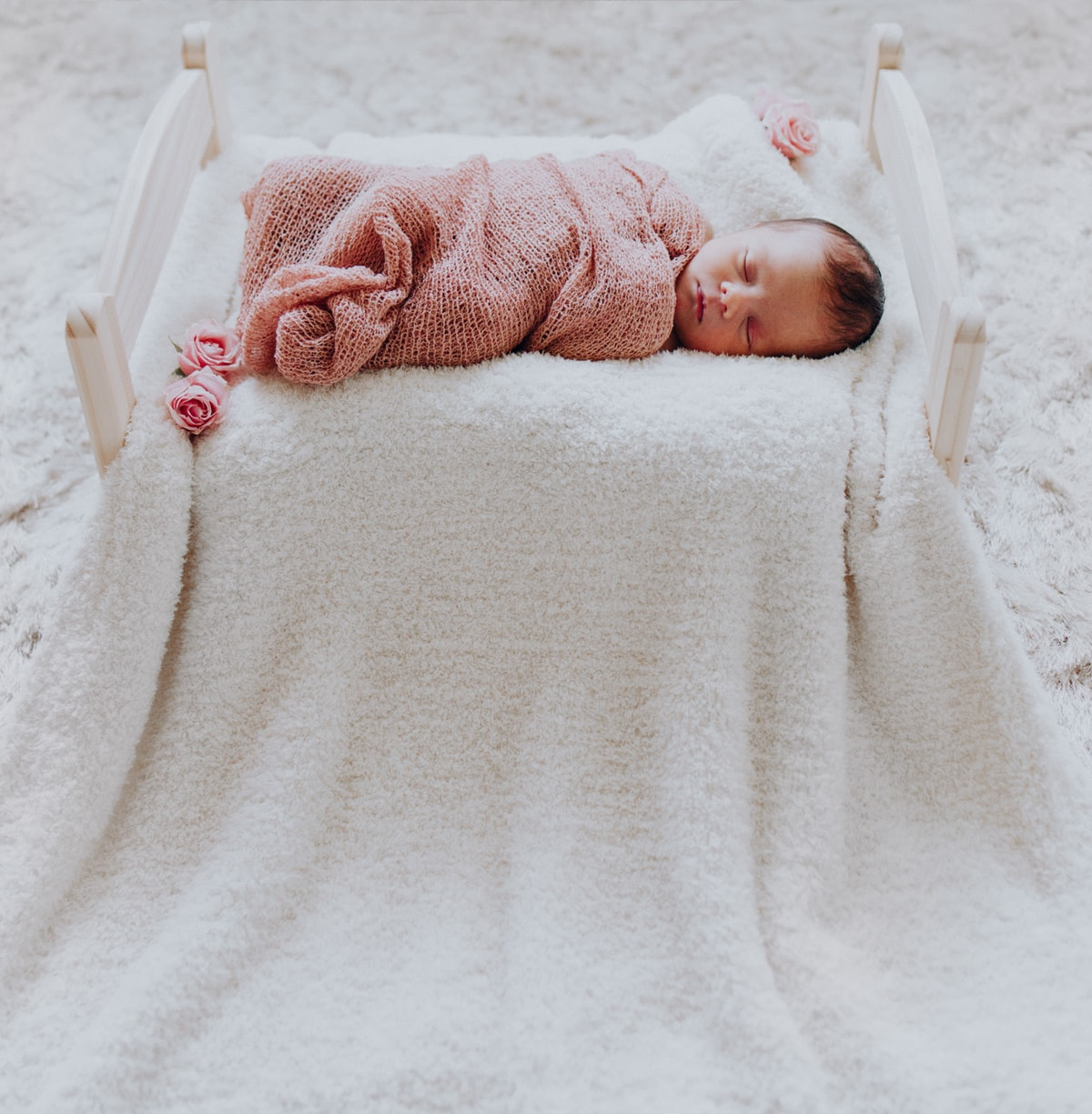 baby swaddled for newborn photos