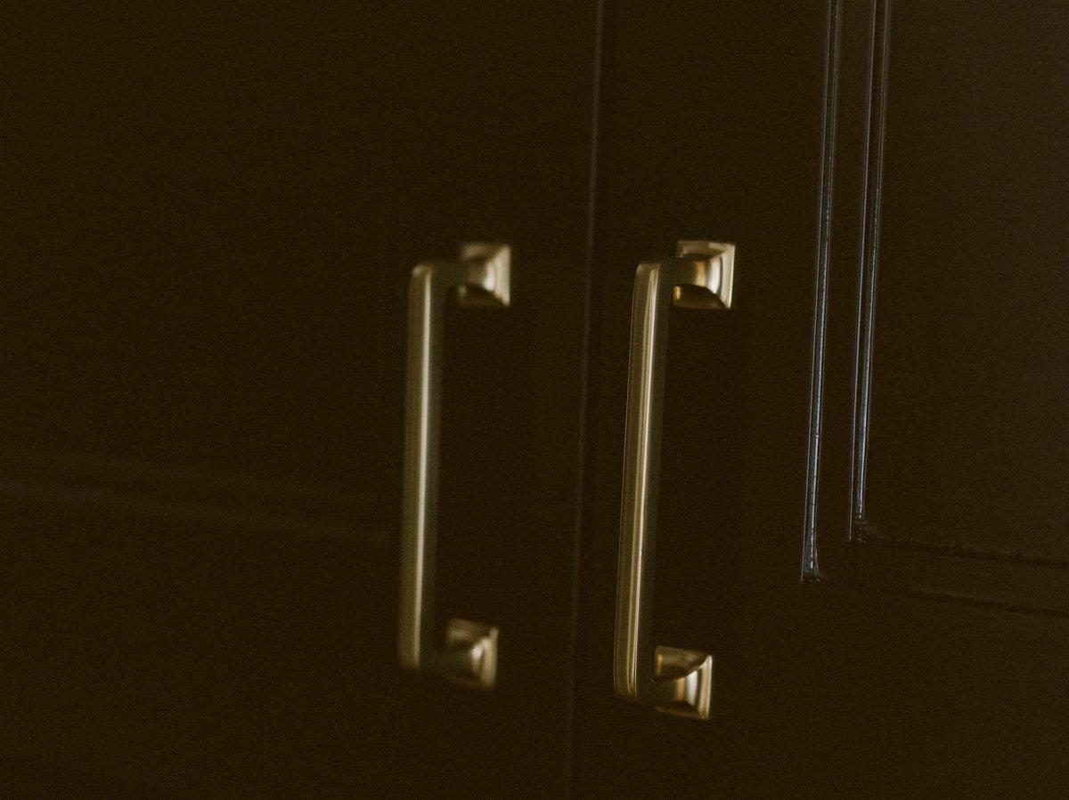 gold hardware dark cabinets