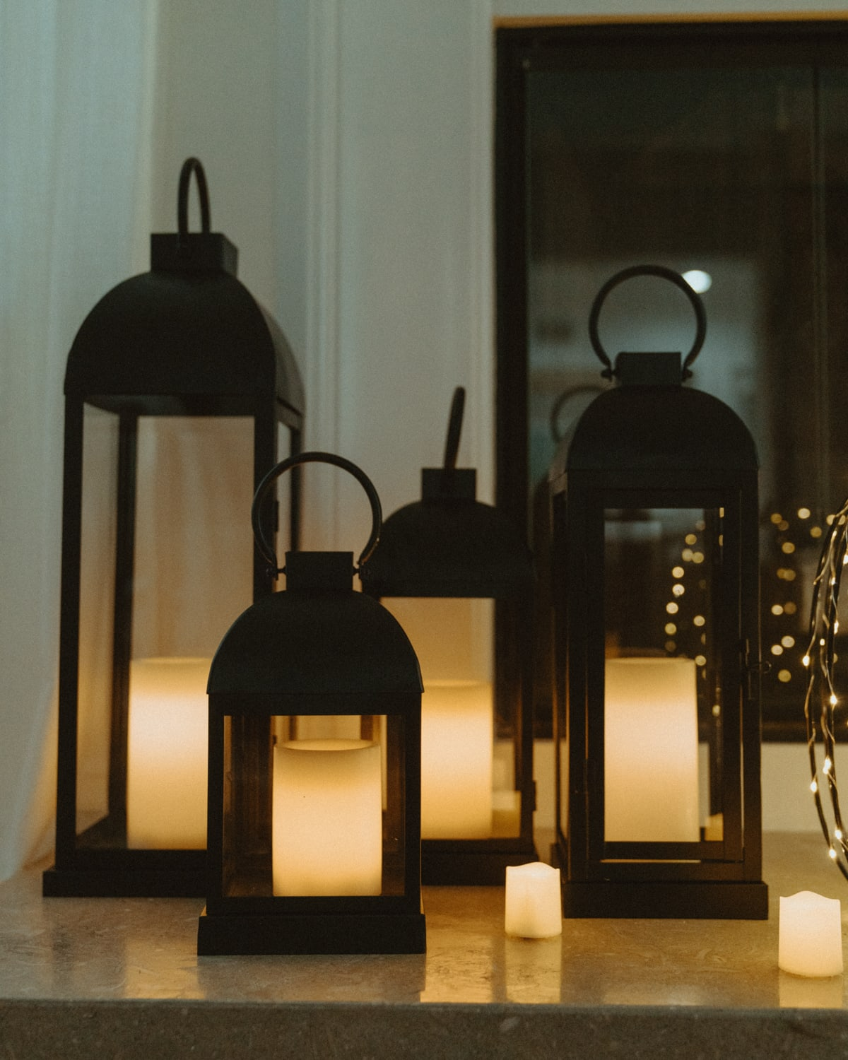 black lanterns and candles